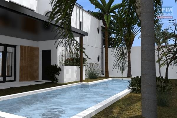 A vendre villa neuve de type 4 avec piscine à la possession ville proche des commerces et lycée.